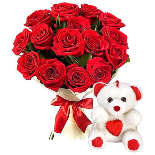 Pleasant Bouquet of 12 Red Rose and a Sweet Teddy